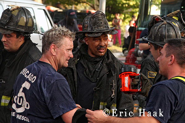 Chicago firemen talk after fighting fire