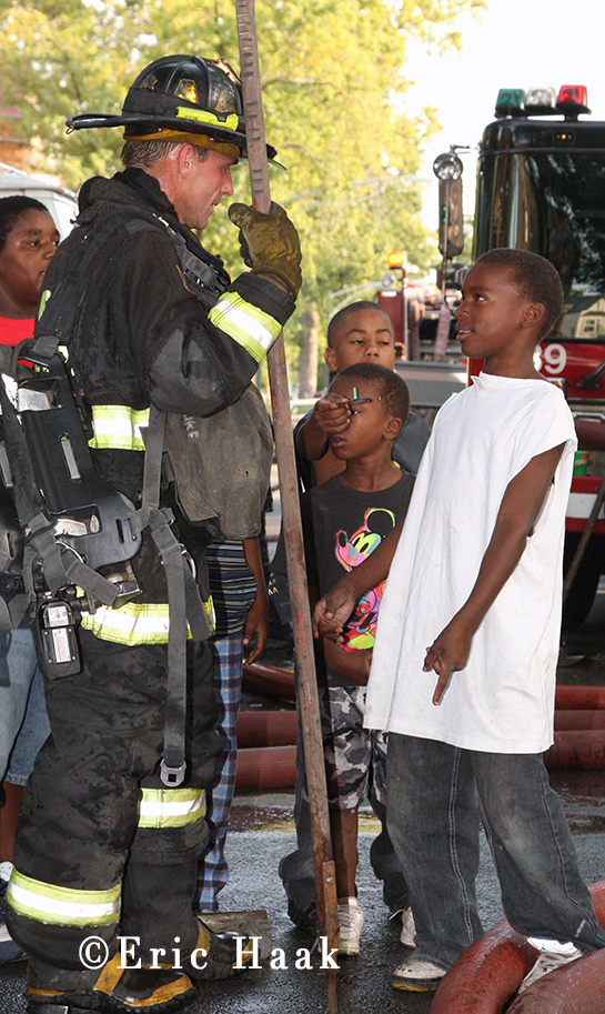 Chicago fireman talks to kids after fighting fire