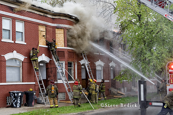 Detroit firemen fighting vacant building fire