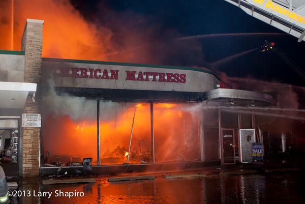 massive 4-11 alarm fire destroys stores on Chicago's north side