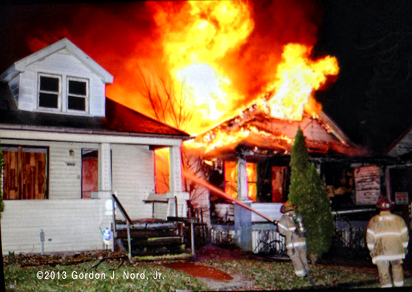 Detroit firemen battle vacant house fire at night