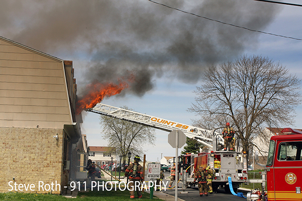 firemen battle Townhouse fire in Hanover PA