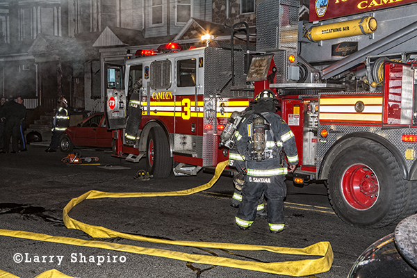 Camden firemen battle 2-alarm fire at night in vacant row house