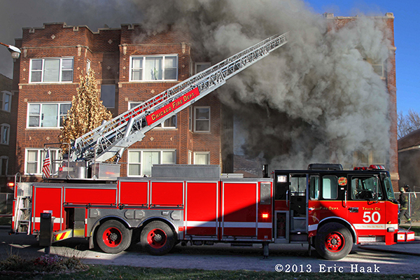 Chicago firefighters battle smokey blaze