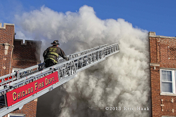 Chicago fireman on ladder with massive smoke at fire scene