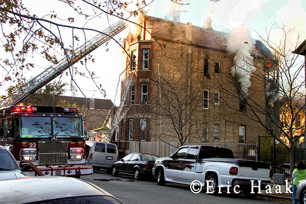 Chicago firemen battle fatal apartment fire