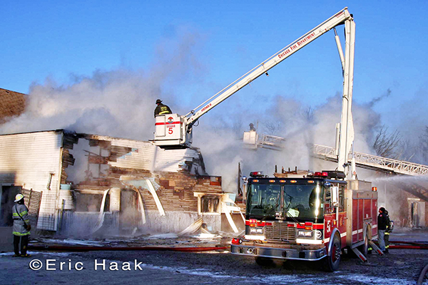 Chicago firemen battle fire in sub-zero weather