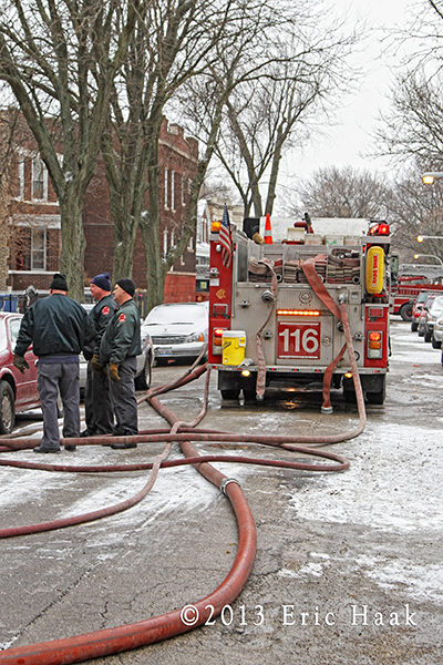 Chicago firemen battle Christmas day house fire