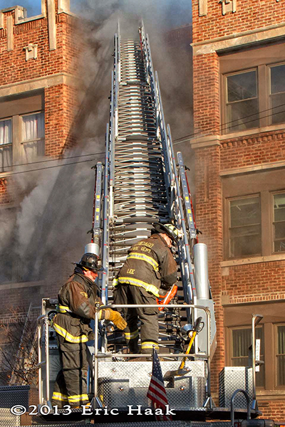 Chicago firemen battle a winter fire in a four-story apartment building 12-7-13.