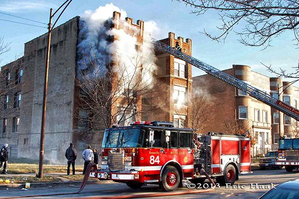 Chicago firemen battle a winter fire in a four-story apartment building 12-7-13