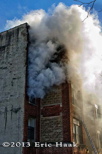 Chicago firemen battle a winter fire in a four-story apartment building 12-7-13. Eric Haak photo