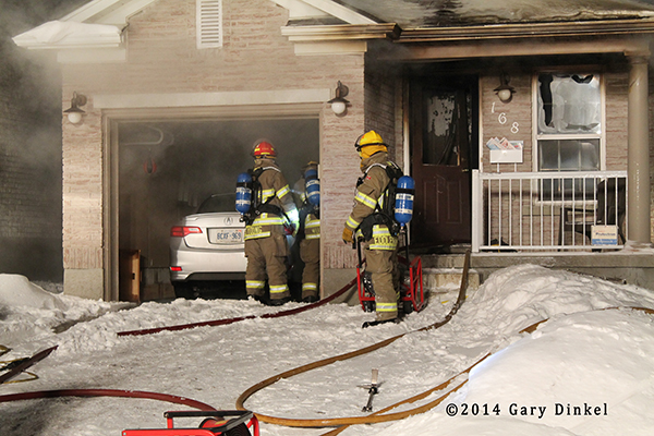 Kitchener firemen battle house fire