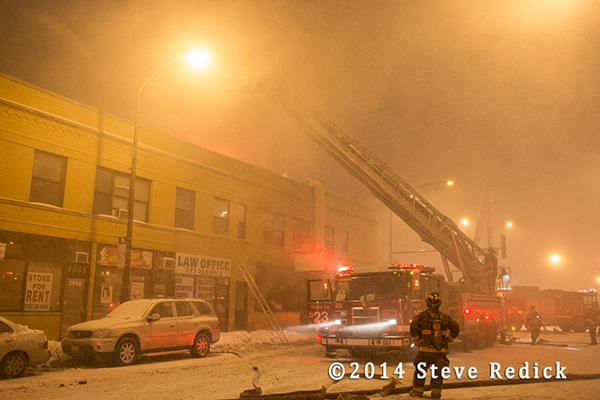 night fire scene in frigid temperatures and blowing snow
