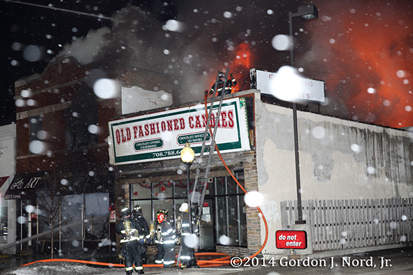 firemen battle commercial fire in snow