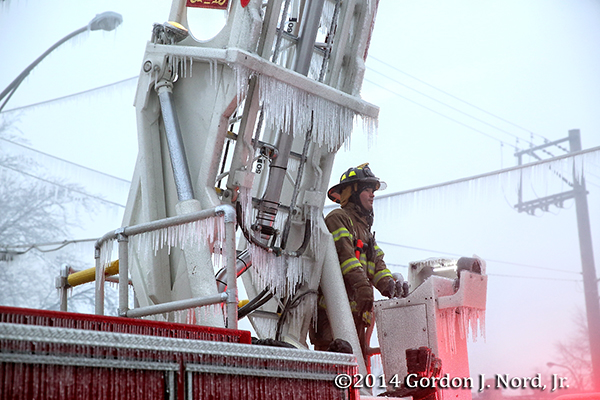fireman with ice on ladder after fighting fire