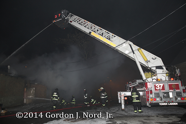 Chicago FD LTI Tower Ladder 37 working at a night fire scene