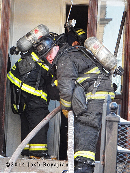 firefighters make entry with hose