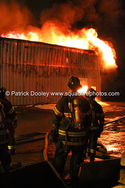 Hartford firemen battle commercial fire at night