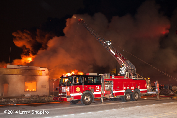 Seagrave ladder truck at night fire scene