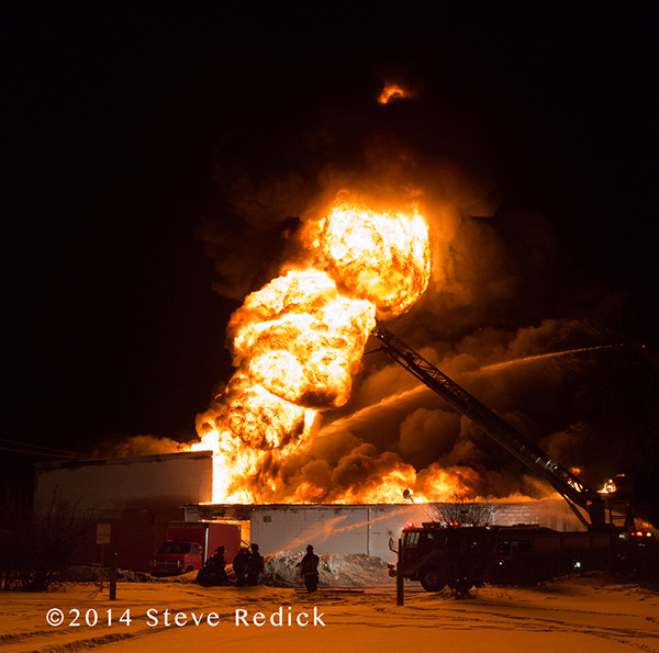 massive fire ball from warehouse fire at night