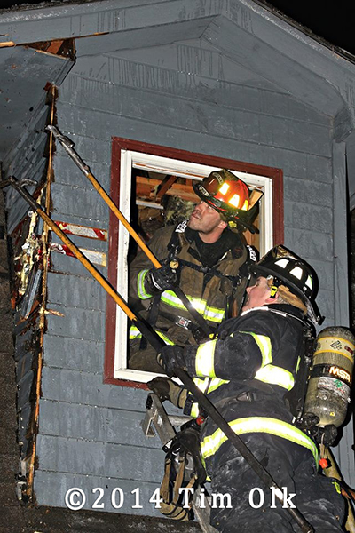 firemen doing overhaul at winter house fire