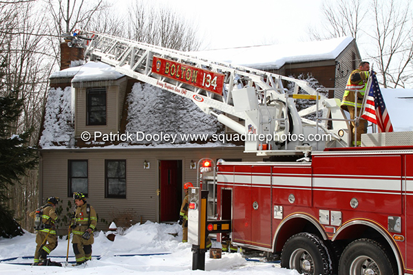 firemen check chimney after fire