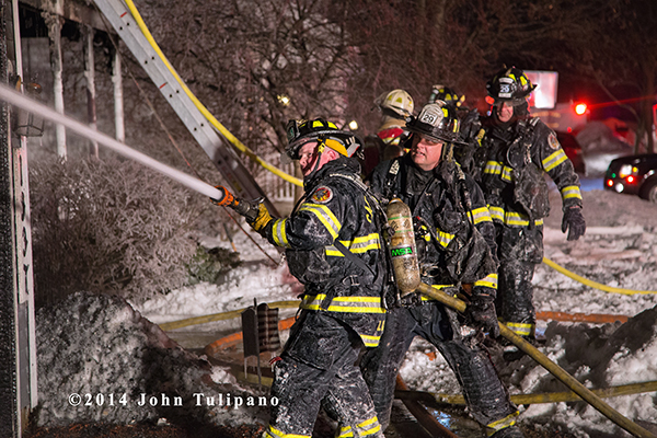 firemen covered with ice at house fire