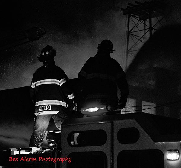 silhouette of firemen at night