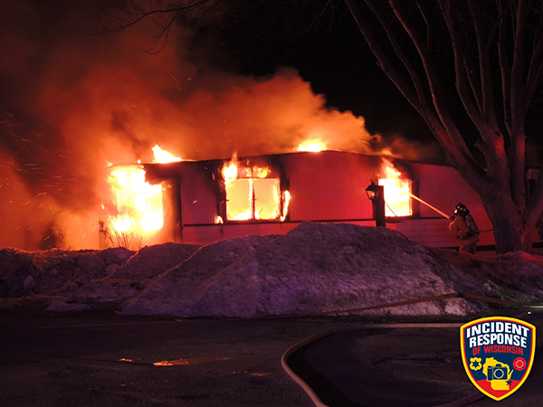 mobile home fully engulfed in fire