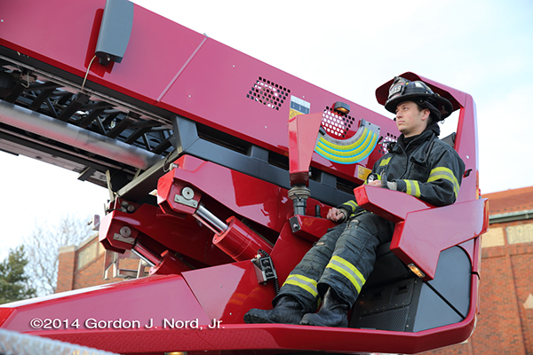 firefighter operating Rosenbauer America Raptor aerial