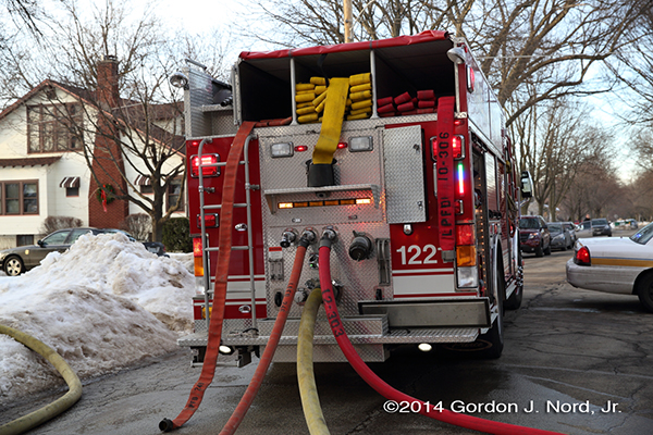 hose lines connected to rear pump fire engine