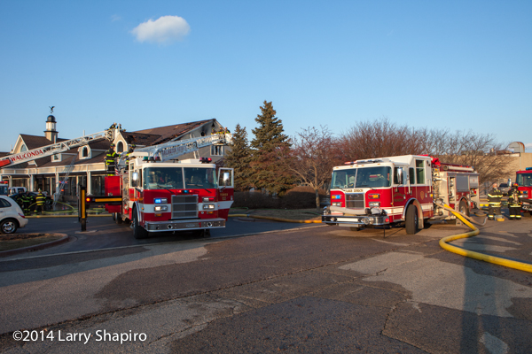 Pierce fire trucks at fire scene