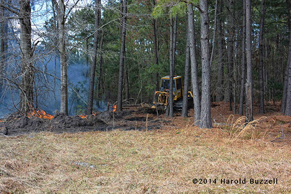 tractor works at forestry fire