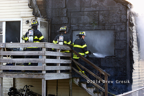 firemen with hose line