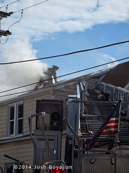 fireman on roof at fire scene