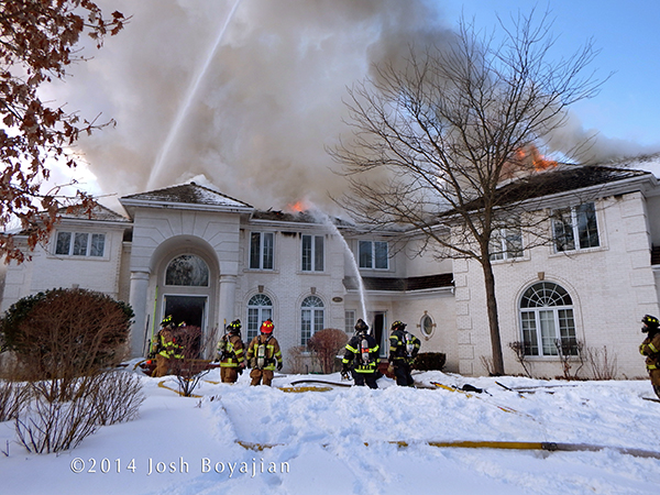 big house on fire in the winter