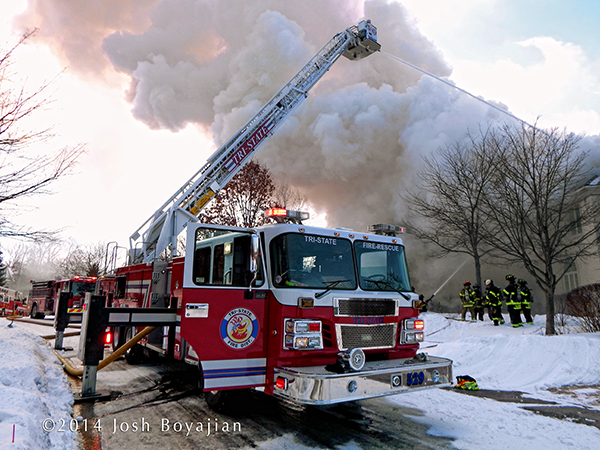 Smeal tower ladder at winter fire scene