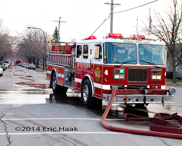 Seagrave fire engine hooked to hydrant