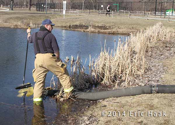 fireman drafting water from a pond