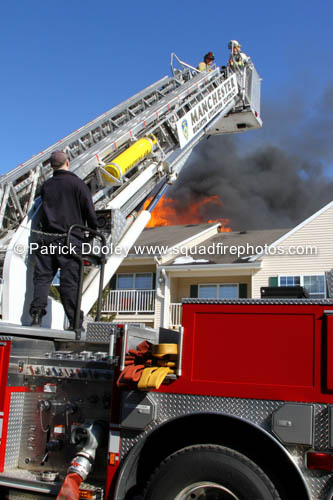 mid-mount tower ladder wt fire scene