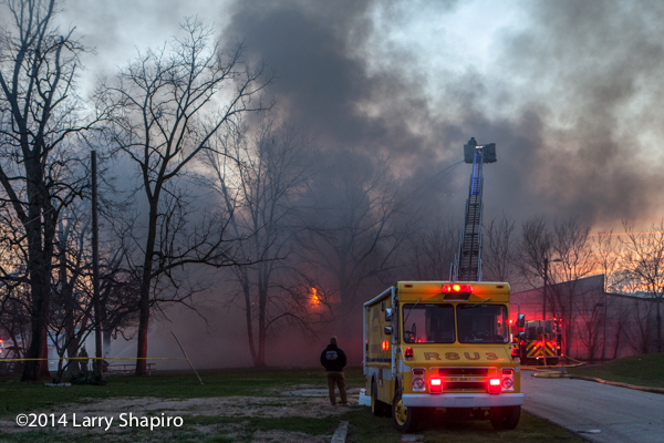 firemen at Indianapolis fire scene with lots of smoke