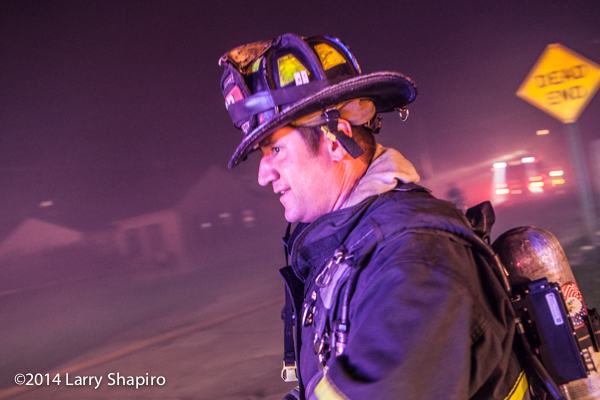 fireman at Indianapolis fire scene with lots of smoke