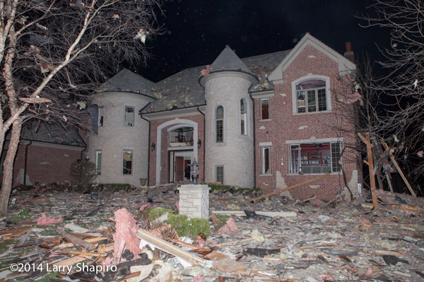 house heavily damaged by explosion