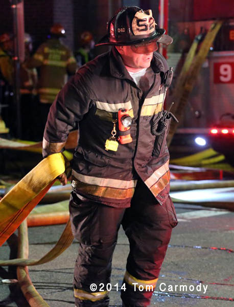Boston fireman at night fire scene