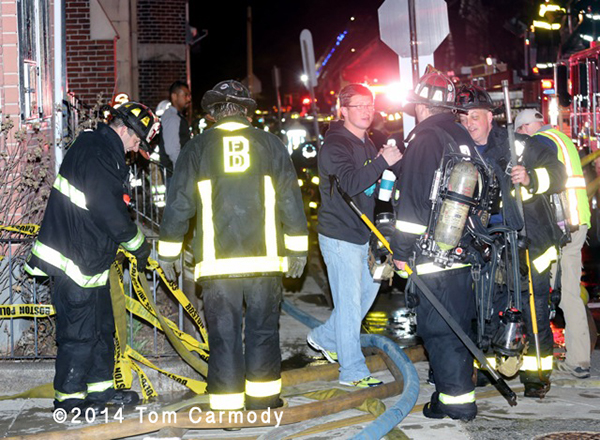 Boston firemen at night fire scene