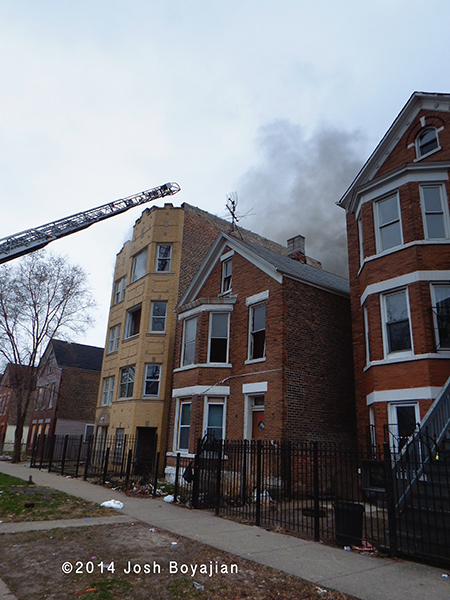aerial ladder to roof of building on fire