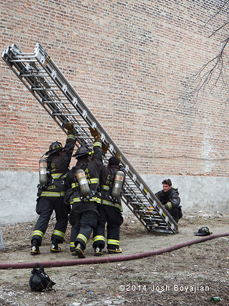 fireman raise a banger ladder