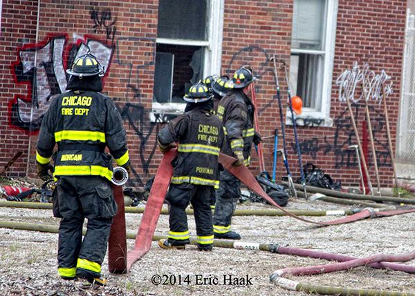 firemen carrying large diameter hose LDH