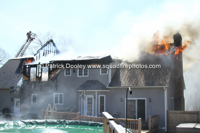 flames through roof at house fire