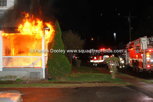 front of house fully engulfed when firemen arrive at night